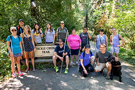 A group photo of campers at Camp GDB at the trailhead of a hiking path