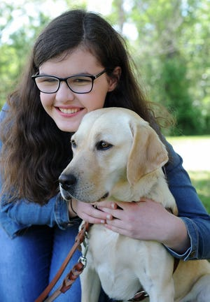 Elana and her yellow Lab guide dog, Lynna