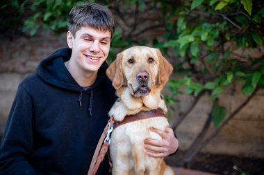 Matthew Simmons and his guide dog Granby.
